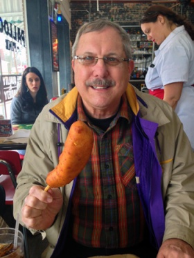 Daddy holds up his corn dog.