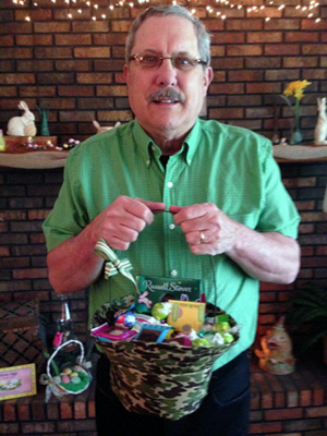 Daddy holds his Easter basket, appropriately covered in camouflage fabric.